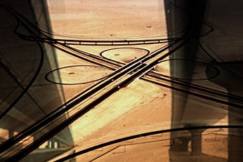 Overhead view of highway roads and bridges in a desert