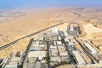Overhead view of an industrial site surrounded by a desert